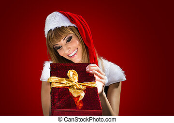Portrait of a santa woman with a christmas gift