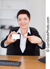 Portrait of a secrertary showing a blank business card