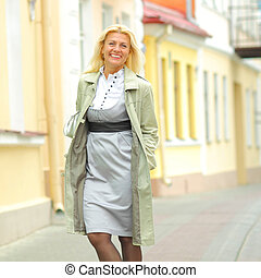 Portrait of a senior business woman outdoors in city.
