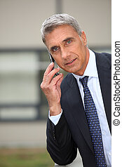 Portrait of a senior businessman talking on phone