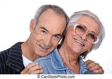 Portrait of a senior couple on white background