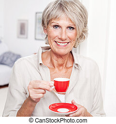 Portrait of a senior lady enjoying espresso