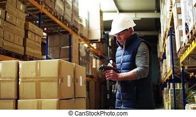 Portrait of a senior male warehouse worker or a supervisor with barcode scanner.