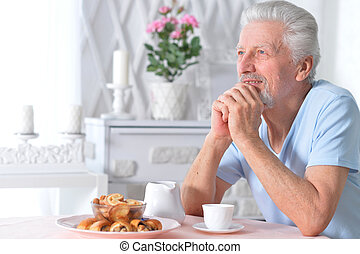 Portrait of a senior man having breakfast