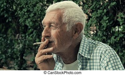 a senior man smoking a cigarette