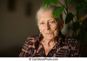 Portrait of a senior woman at home, thinking
