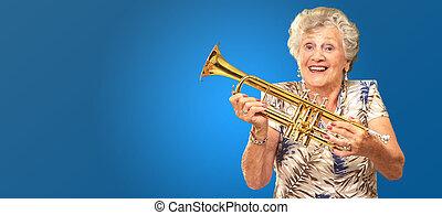 Portrait Of A Senior Woman Holding A Trumpet Portrait Of A ...