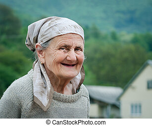 Portrait of a senior woman outdoor - Very old rural woman...