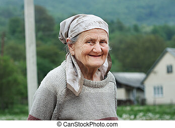 Portrait of a senior woman outdoor. Very old rural woman...
