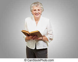 Portrait of a senior woman reading book