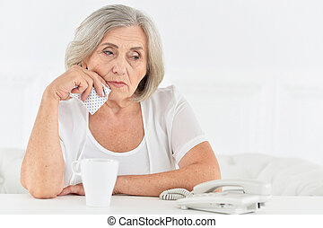 Portrait of a senior woman talking phone