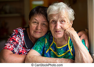 senior woman with adult daughter