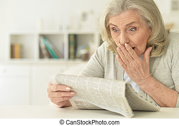 senior woman with newspaper