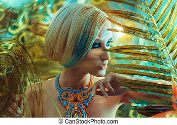 Portrait of a sensual blond lady in the tropics