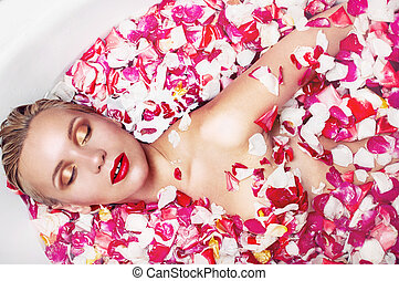 portrait of a sensuall blonde woman in water with rose...