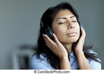 Spanish Woman Listening Music - Portrait Of A Serene Spanish...