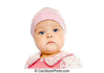 serious baby in a pink hat on a white background