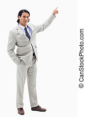 Portrait of a serious businessman pointing at a copy space