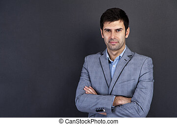Portrait of a serious businessman with smile