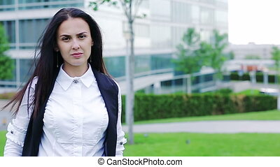 Portrait of a serious businesswoman looking in the camera