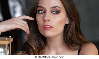 portrait of a serious female model looking at camera