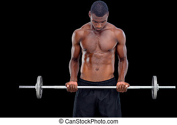 Portrait of a serious fit young man lifting barbell