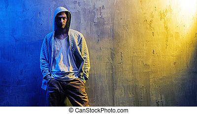 Portrait of a serious hip-hop boy