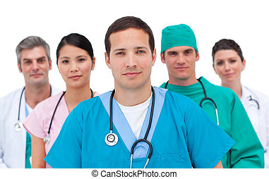 Portrait of a serious medical team against a white...