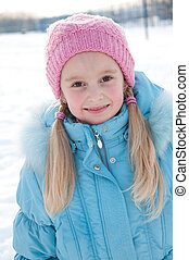 Portrait of a seven-year-girl in winter clothes