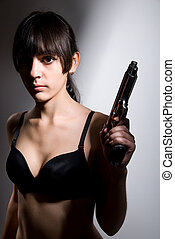 Portrait of a sexy girl with a gun