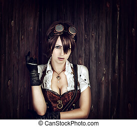 Portrait of a sexy steampunk woman with big breast wearing...