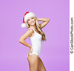 Portrait of a sexy woman in a swimsuit and a Santa hat