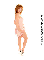 Portrait of a sexy young woman in pink dress