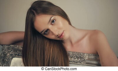 Portrait of a sexy young woman with long hair