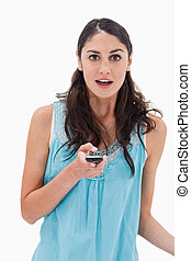 Portrait of a shocked woman reading a text message