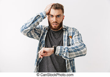 Portrait of a shocked young bearded man