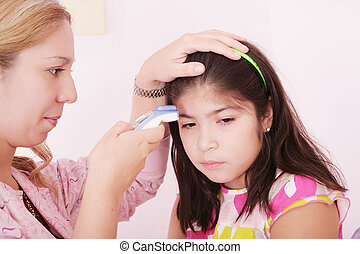 Portrait of a sick child being checked with a thermometer by a doctor