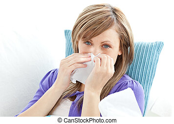 Portrait of a sick pretty woman blowing