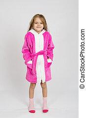 Portrait of a six-year growth girl in bathrobe