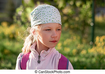 portrait of a six-year-old girl in a bandana