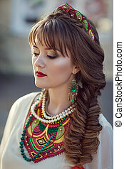 portrait of a Slavic girl in a national costume