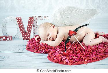 Portrait of a sleeping cupid