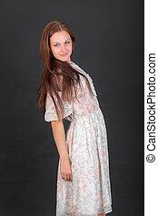 slender girl in a light dress