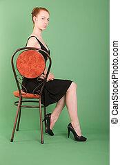 slender girl on a chair