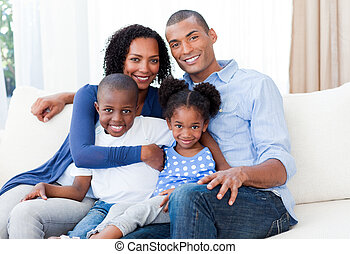 Portrait of a Smiling Afro-american family on the sofa