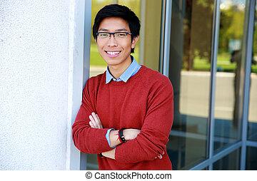 Portrait of a smiling asian man wit