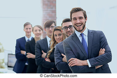 portrait of a smiling business team in office .