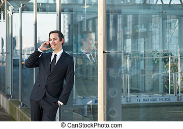 Portrait of a smiling businessman calling by mobile phone