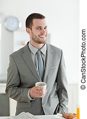 Portrait of a smiling businessman having breakfast