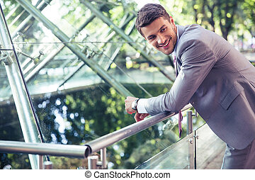 Portrait of a smiling businessman outdoors